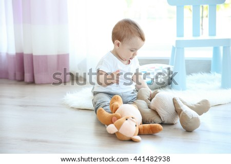 Cute baby boy with teddy bear - stock photo