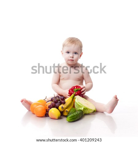 Cute baby boy with vegetables isolated on white background