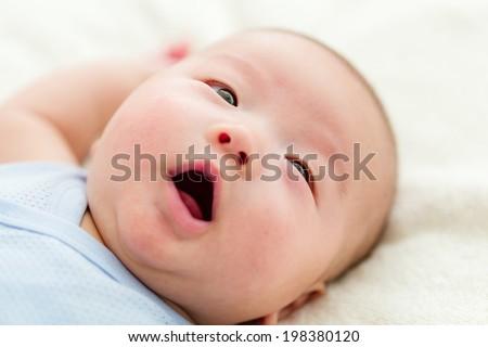 Cute baby boy yelling - stock photo