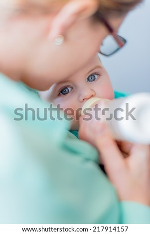 Cute baby brinking from a bottle