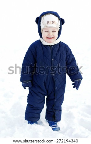 cute baby child smiling on white winter snow background  - stock photo