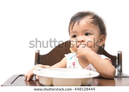 Cute baby  eating by herself