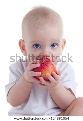 cute baby eating red apple on white background
