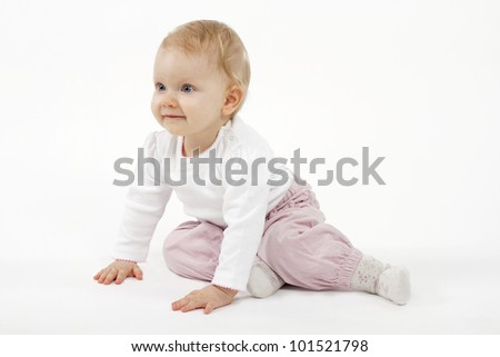 Cute baby girl against white background