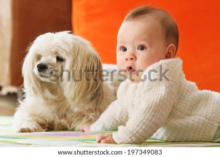 Cute Baby Girl and her Dog in Narrow Focus