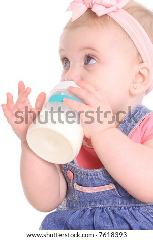cute baby girl drinking a bottle - stock photo