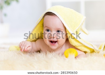 Cute baby girl in bath towel indoors - stock photo