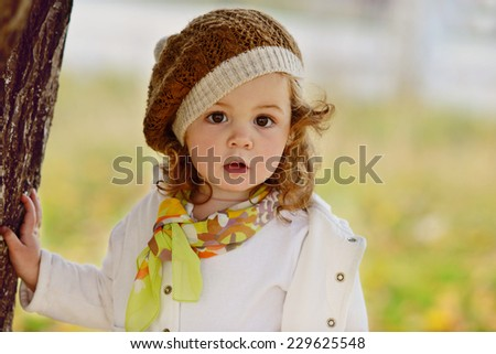 cute baby girl in fall time - stock photo
