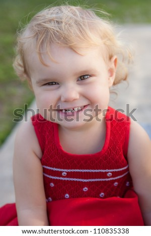Cute baby girl in red dress - stock photo