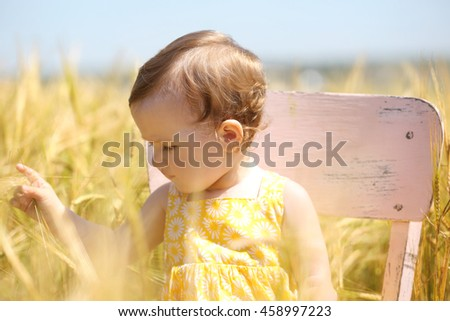 Cute baby girl in summer meadow