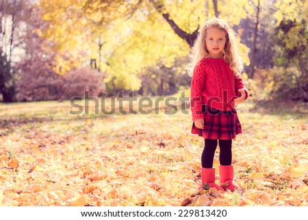 Cute baby girl in the autumn forest - stock photo