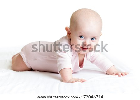 cute baby girl lying on her tummy - stock photo