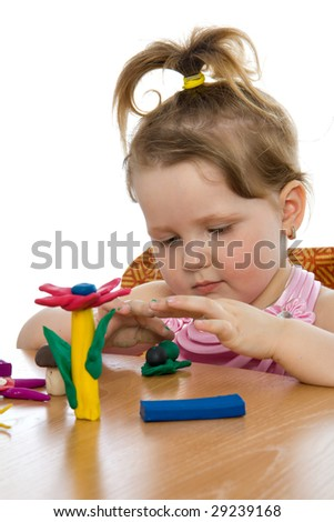 Cute baby girl playing with color play plasticine