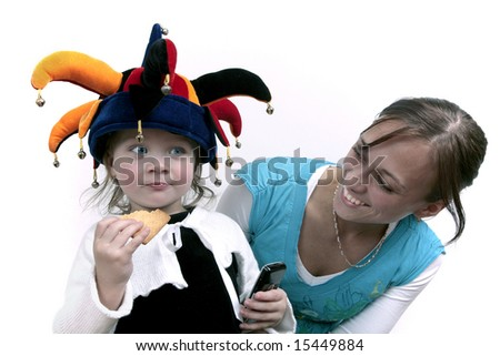 Cute baby girl posing in clown hat with mommy - stock photo