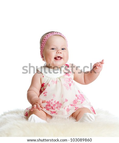 cute baby girl sitting and smiling - stock photo