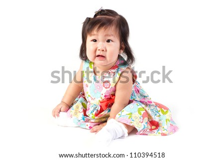 Cute baby girl sitting in studio and her face is bored isolated on white