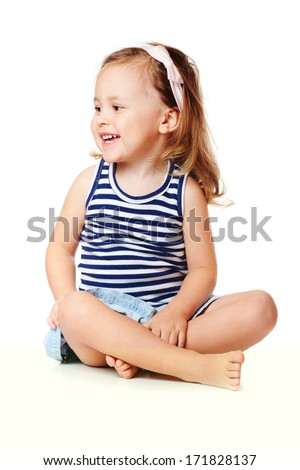 Cute baby girl sitting, isolated over white