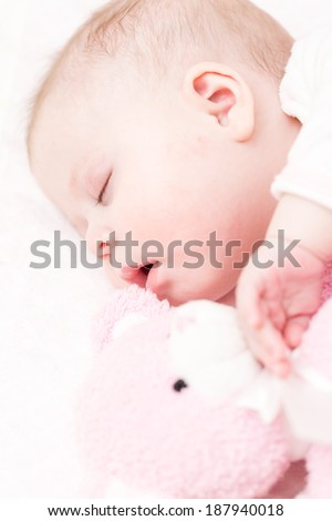 Cute baby girl sleeping in her crib. - stock photo
