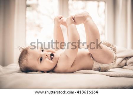 Cute baby girl smiling cheerfully - stock photo