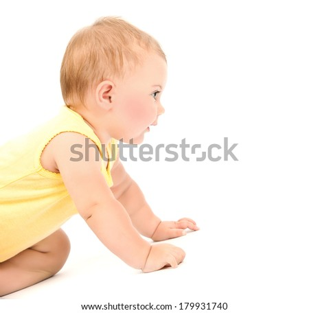 Cute baby girl wearing yellow dress isolated on white background, crawling in the studio, healthy lifestyle, happy childhood concept  - stock photo