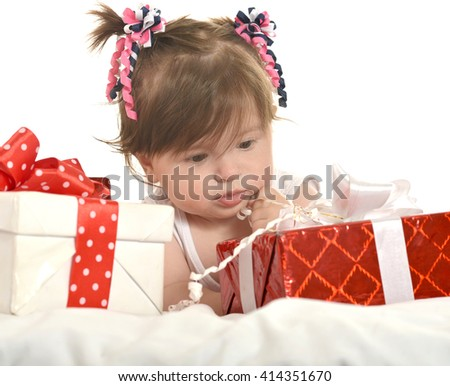 Cute baby girl  with gifts - stock photo