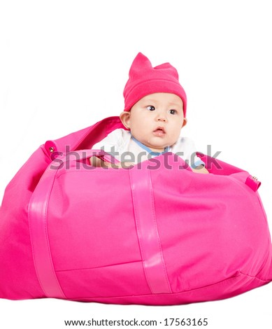 cute baby in a big bag. - stock photo