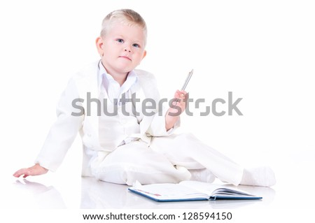Cute baby in a white business suit with a diary - stock photo