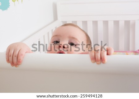 Cute Baby in Crib - stock photo