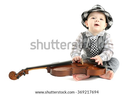 Cute baby in hat with violin isolated on white background