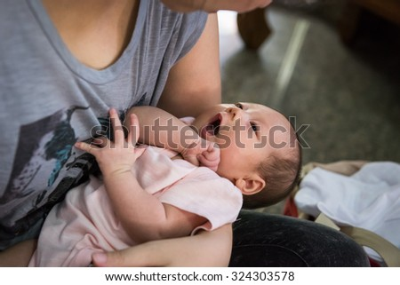 Cute baby in mother's hand, baby is talking