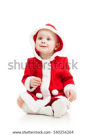 cute baby in Santa Claus clothes - stock photo