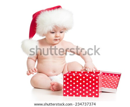 cute Baby in Santa hat playing with Christmas gift box isolated on white background - stock photo