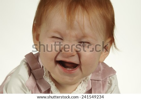 Cute baby laughs - stock photo
