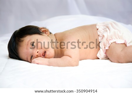 cute baby lie prone - stock photo
