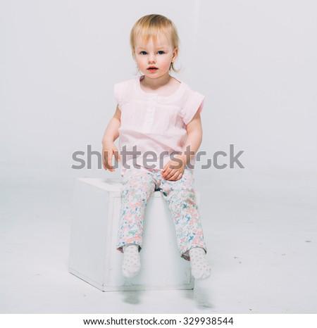 Cute baby little girl blonde studio portrait happy smiling  - stock photo