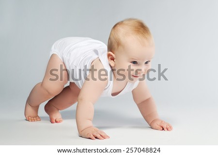Cute baby lying in diaper  on white background