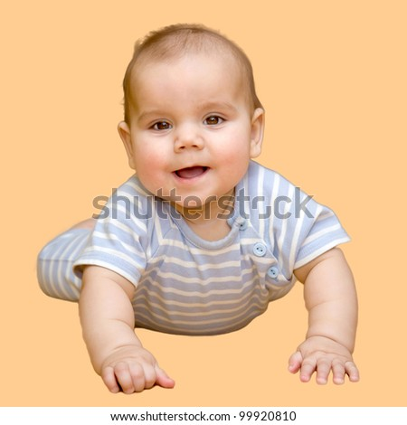 Cute baby lying isolated on a beige background - stock photo