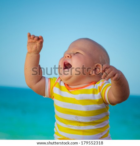 Cute baby on the tropical beach - stock photo