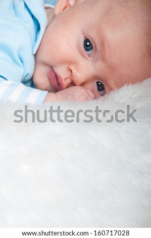 Cute baby on white rug
