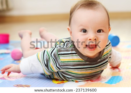 Cute Baby Playing on a colorful Play Mat - stock photo