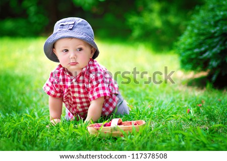 cute baby sitting in the grass - stock photo