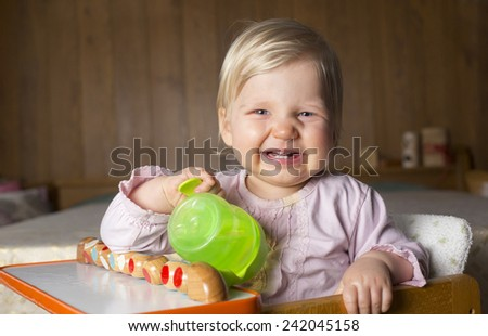 Cute Baby sitting on highchair smiling - stock photo