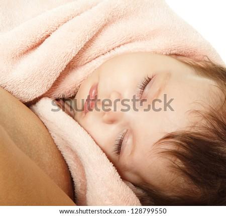 cute baby sleeping on mother's hands, beautiful kid's face closeup, studio shot - stock photo