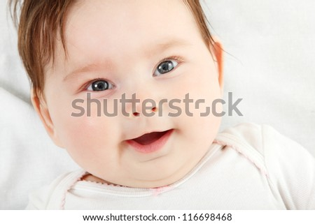 cute baby smiling, beautiful kid's face closeup with copyspace