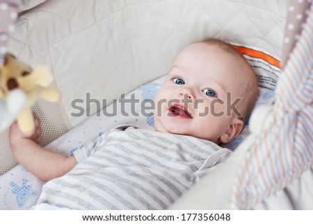 Cute  baby smiling looking at the camera - stock photo