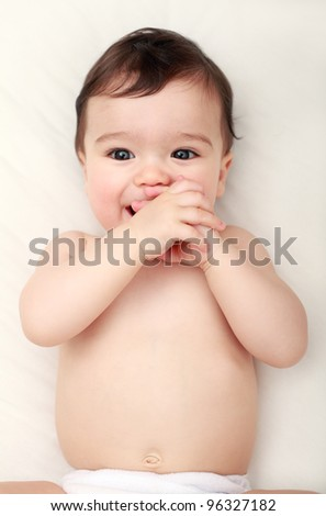 Cute baby sucking his hands - stock photo
