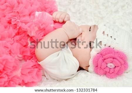 cute baby wearing a pink tutu - stock photo