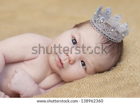 cute baby with a crown   - stock photo