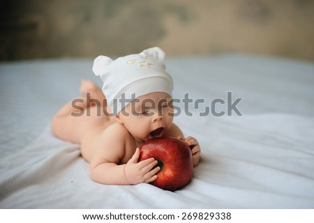 Cute baby with a huge red apple, health, lifestyle - stock photo