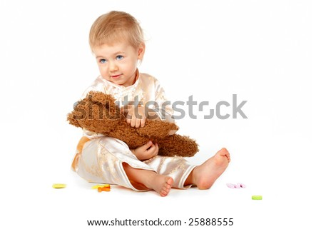Cute baby with alphabet letters and teddy bear